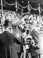 Jim Thorpe receiving Olympic gold medal from King Gustav V of Sweden